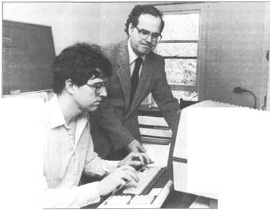 Professor John Traill (right) and assistant Douglas Orr cataloguing names of the lesser-known Athenians